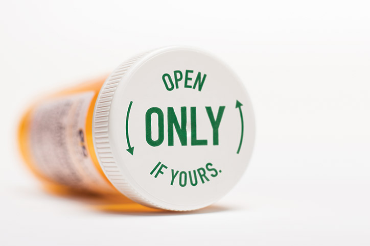 "Pill Bottle laying on it's side showing ""Open Only If Yours"""